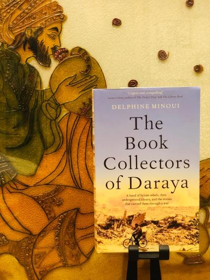 The Book Collectors of Daraya, shot against mum's glass color painting of Omar Khayyam!